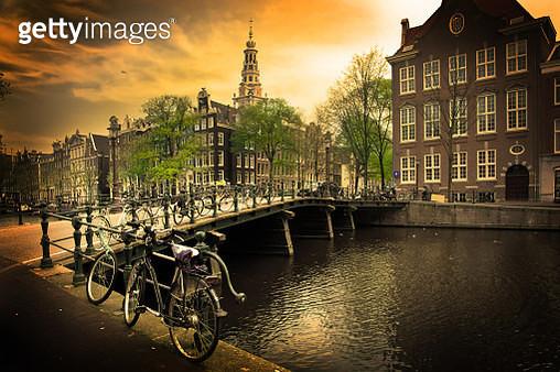 Amsterdam. Romantic canal bridge, bike - gettyimageskorea