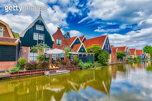 A traditional Dutch village with colorful, old wooden houses and canals - gettyimageskorea