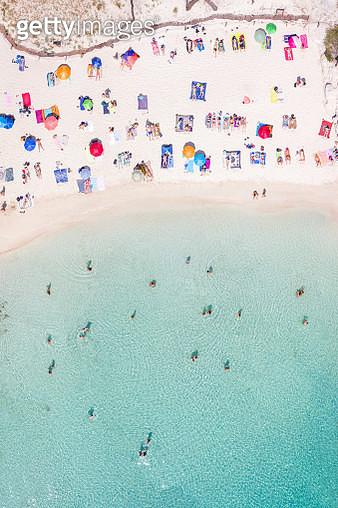 Aerial of Cala Macarelleta beach crowded, Menorca - gettyimageskorea