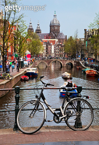 Amsterdam old town canal, boats. - gettyimageskorea