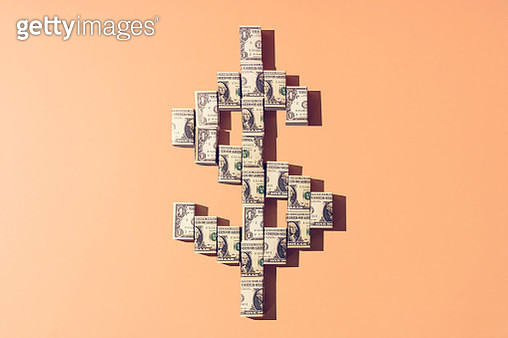 Still life of folded american dollar notes making a shape of the dollar currency sign. - gettyimageskorea