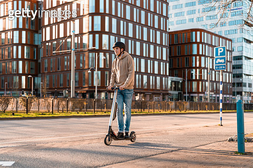 Teenager riding an Electric Scooter in the City - gettyimageskorea
