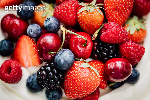 Close-up of berry cake on table. Fresh raspberry, blackberry, blueberry and strawberry cheesecake. - gettyimageskorea