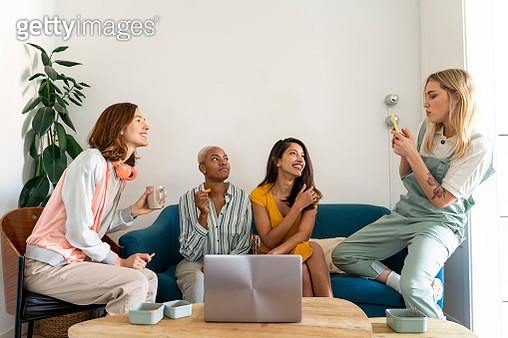 Four women sitting on couch - gettyimageskorea