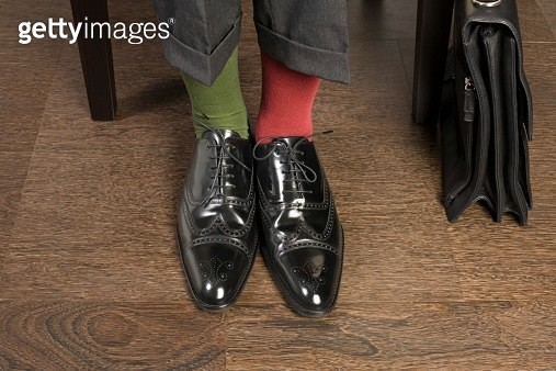 Man wearing odd socks - gettyimageskorea