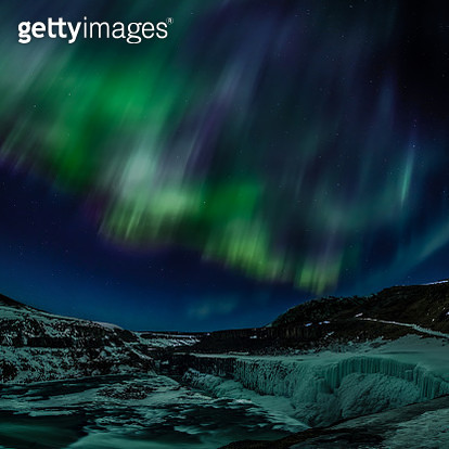 Northern lights over mountains, Iceland - gettyimageskorea