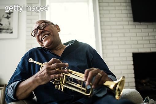 Portrait of senior man with trumpet - gettyimageskorea