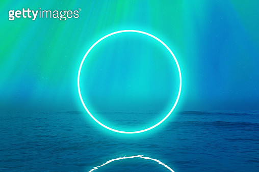 Perfect green neon ring glowing over the sea with stunning northern lights in Iceland. - gettyimageskorea