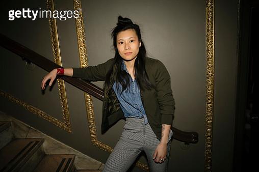 Portrait confident, cool female millennial in nightclub - gettyimageskorea