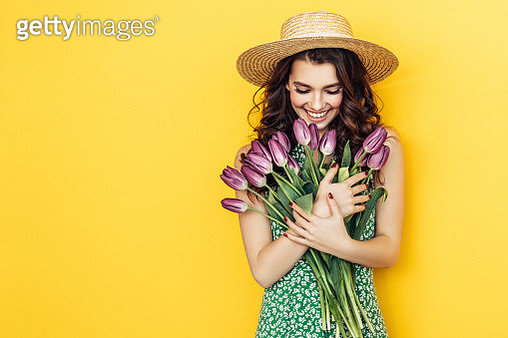Lovely woman with purple tulips bunch - gettyimageskorea