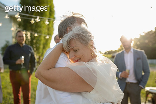Affectionate senior bride and groom dancing - gettyimageskorea