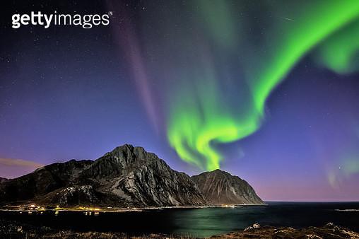 Aurora Borealis over Mt Store Nappstind, Napp, Flakstad, Nordland, Lofoten, Norway - gettyimageskorea