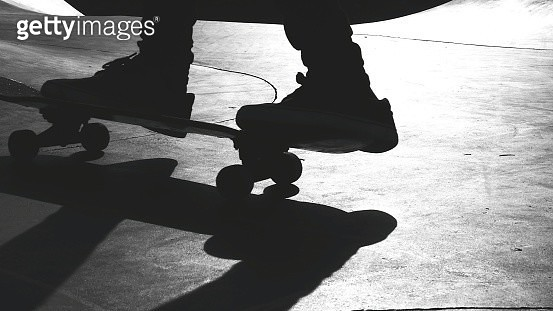 Low Section Of Man Skateboarding At Skateboard Park - gettyimageskorea