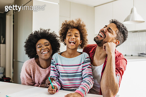 Portrait of African American family learning with kid at home - gettyimageskorea