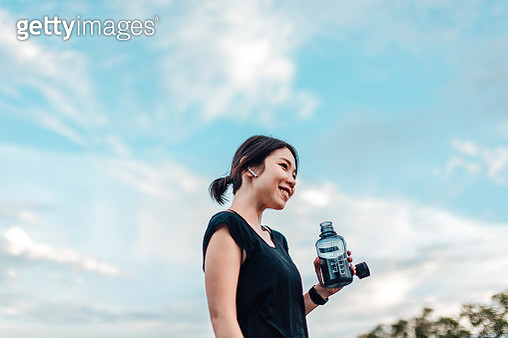 Cheerful Young Woman With Water Bottle After Exercising - gettyimageskorea