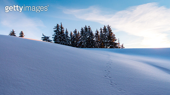 Winter mountain scene with fresh snow and Alps mountain range in background in Switzerland - gettyimageskorea