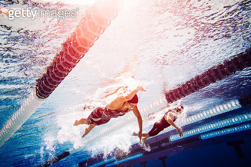 Swimmers doing freestyle in lane - gettyimageskorea