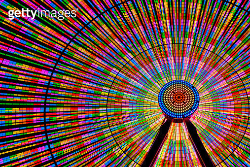 Spinning ferris wheel illuminated at night - gettyimageskorea