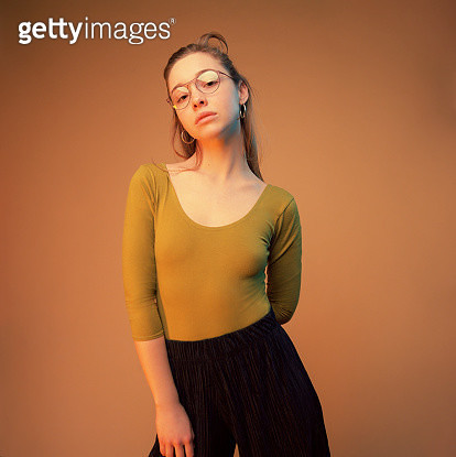 Studio shot of young woman wearing glasses - gettyimageskorea
