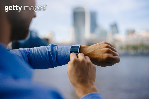 Businessman using smartwatch. - gettyimageskorea