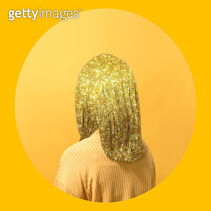 Woman in yellow facing yellow background - gettyimageskorea
