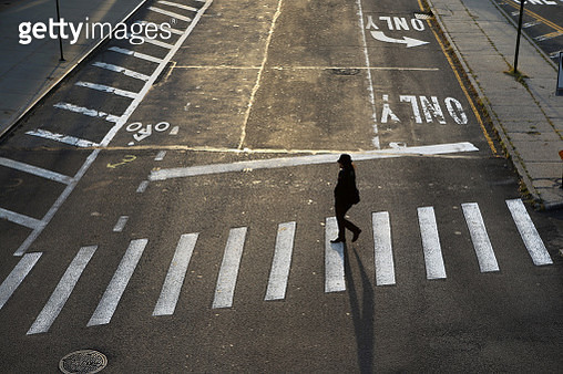 A woman crossing a street in Dumbo, Brooklyn, New York City, USA - gettyimageskorea