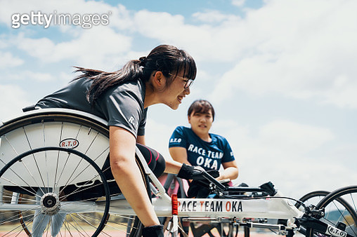 Young female wheelchair racers before a competition at a track and field event in Japan - gettyimageskorea