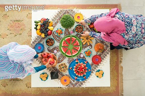Two females preparing food decorated table - gettyimageskorea