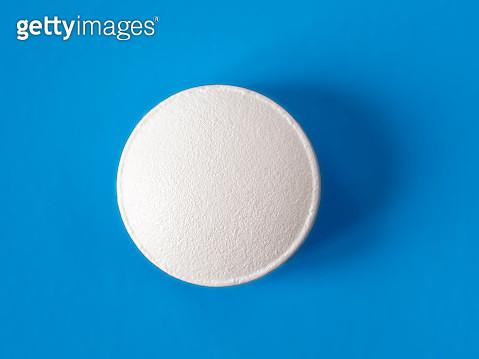 Medicine pill on a blue background. - gettyimageskorea