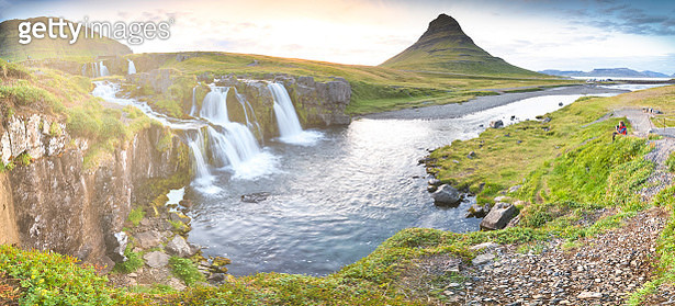 The majestic Kirkjufell with solo traveller takeing a photo in summer, Iceland - gettyimageskorea