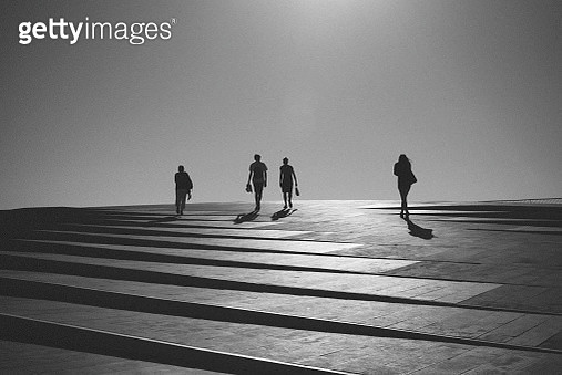 Silhouette People Walking Against Clear Sky During Sunny Day - gettyimageskorea