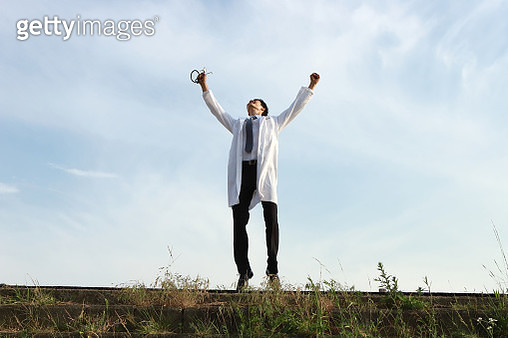 Cheerful young doctor jumping - gettyimageskorea