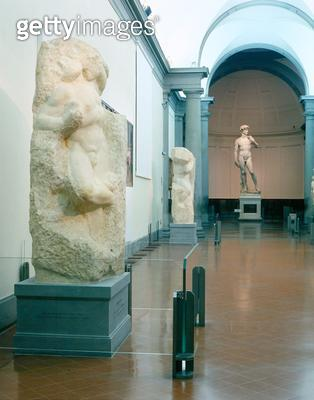 <b>Title</b> : Interior view of the gallery with Michelangelo's 'Awakening Slave' and 'David' in the background (photo)<br><b>Medium</b> : <br><b>Location</b> : <br> - gettyimageskorea
