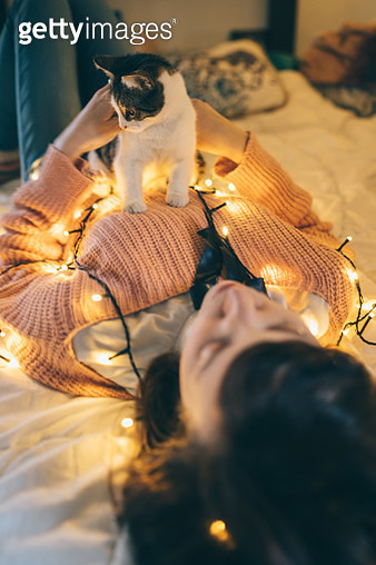 Woman, cat and christmas lights - gettyimageskorea