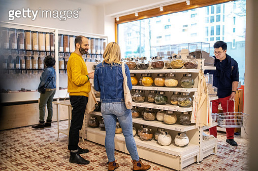 Customers shopping at food at zero waste store - gettyimageskorea