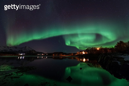 Northern Lights over a Fjord in Northern Norway during a cold winter night - gettyimageskorea