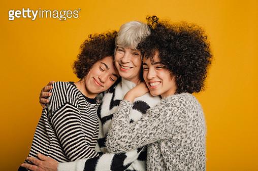 Teenage Twins Embracing Their Mother - gettyimageskorea