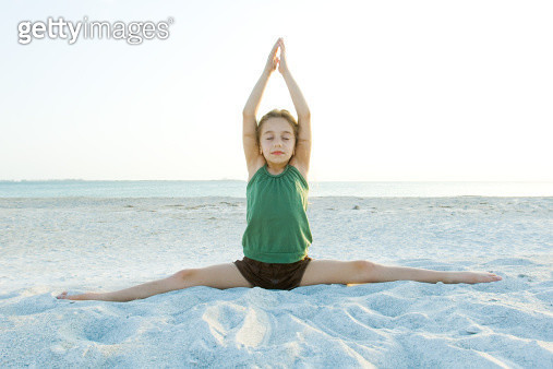 Girl doing yoga on beach - gettyimageskorea