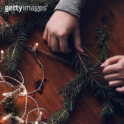 Teenage girl making a Christmas wreath - gettyimageskorea