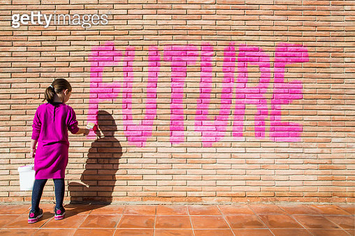 Kid thinking about the future in a protest to the adults to ensure a future education and better live. - gettyimageskorea