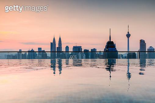 Infinity pool overlooking Kuala Lumpur skyline. Malaysia - gettyimageskorea