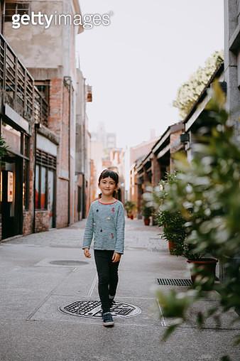 Cute young mixed race girl walking on street of Taiwan - gettyimageskorea
