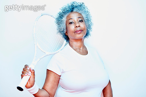 older woman holding tennis racket - gettyimageskorea