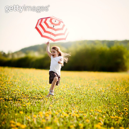 Little girl with umbrella - gettyimageskorea