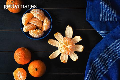 Mandarin oranges on black background - gettyimageskorea