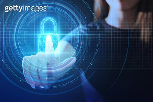 Young woman touching UI security padlock - gettyimageskorea