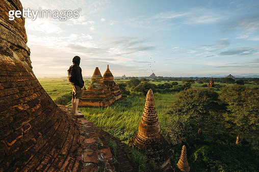 Tourist standing on Bagan Pagoda during sunrise in Myanmar - gettyimageskorea