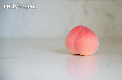 Close-Up Of Peach On Table - gettyimageskorea