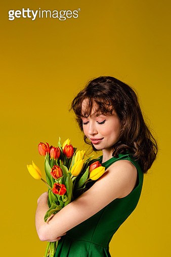 Woman holding tulips - gettyimageskorea