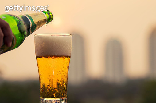 Beer glass and sunset background - gettyimageskorea